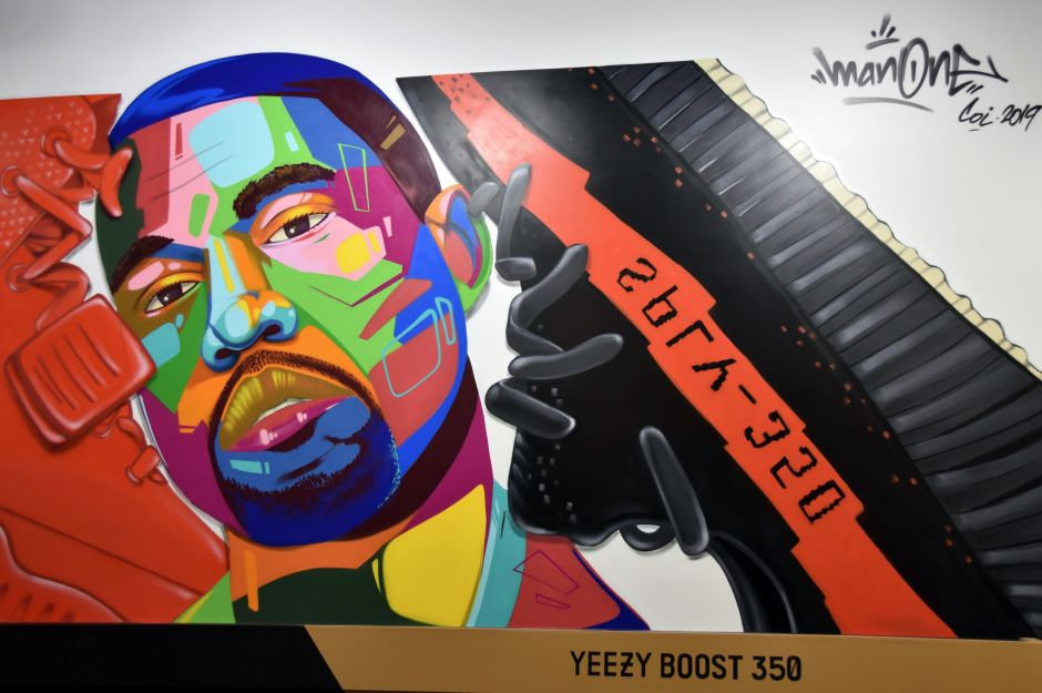 """The muralist """"Man One"""" portrayed the American singer-songwriter Kanye West next to a shoe."""
