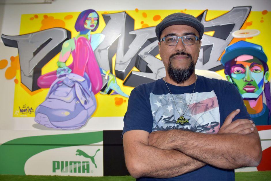Angelian artist Alejandro Poli Jr. (Man One) is one of Sneakertopia's muralists.