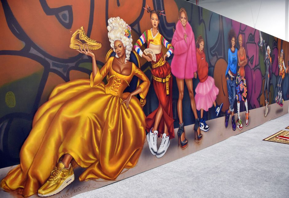 Mural with famous singers wearing sneakers.