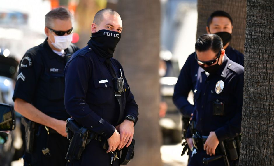 They accuse 3 Los Angeles police officers of cataloging people as gang members falsifying information
